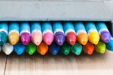 artboard: Close up set of crayon in the box
