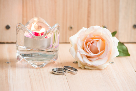 Pastel Pink Rose put near Engage Ring and  candlestick, Valentines concept. Stock Photo