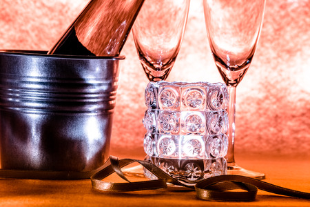 popping cork: selcet focus Candlestick with Cool Champagne and couple glass celebrate in party. ornament for greeting festival.