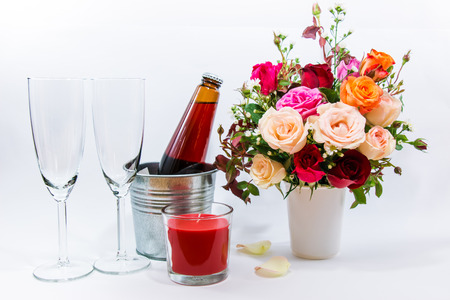 Vase Of Roses Bouquet Candle And Champagne Glass On White