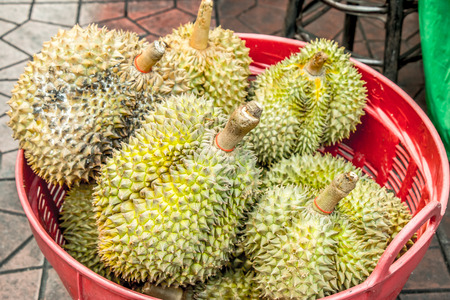 Durain on Basket, king of friut, Food and fruit street in chaina town, Thailand Stock Photo