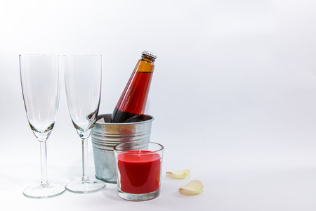 popping cork: champagne, glass, candle, and flower set for celebrating in party, Valentine concept Stock Photo