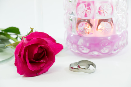 engagement party: Rose and engage ring near champagne glasses, and candle set for celebrating in engagement party, Valentine concept Stock Photo