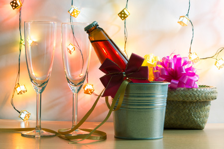 popping cork: Cool Champagne in ice bucket and a couple glass. Pink ribbon and light bulb ornament for Celebration festival.