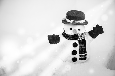 diamond candle: Snow man stand among pile of snow. Morning sunshine is warming in winter. Stock Photo