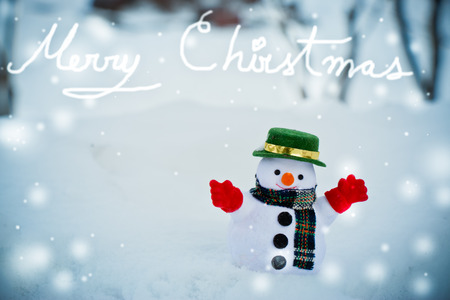 diamond candle: Snow man stand among pile of snow. Morning sunshine is warming in winter. Welcome Christmas.