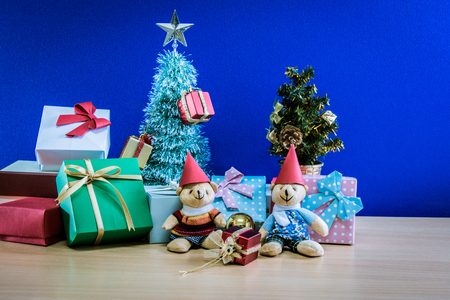 Ornament and a couple lovely teddy bear, Christmas decorate at Merry Christmas and happy new year night light. Christmas tree and other decoration with Lovely gift and ribbon .