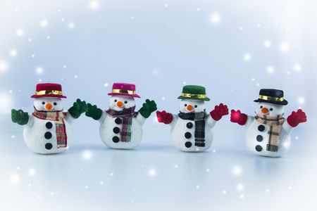 christmas frog: Gang of Snowman stand on white background. Snow flake is falling down.