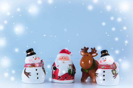 greet card: Santa claus and reindeer stand with Gang of Snowman on white background. Snow flake is falling down.