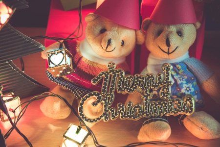 christmas frog: Ornament and a couple lovely teddy bear, Christmas decorate at Merry Christmas and happy new year night light. Christmas tree and other decoration with Lovely gift and ribbon .
