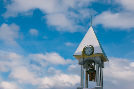 Snow cover over clock tower at biei station in winter, biei Hokkaido, Japan.
