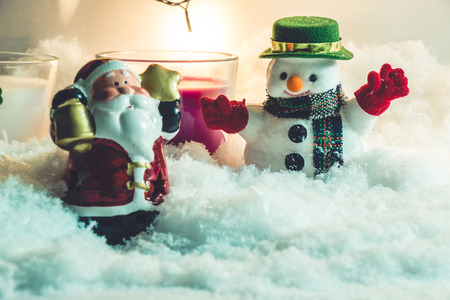 hopefulness: Santa claus hold bell and Star. Snowman, white and violet christmas candle with a light bulb at silent night, the hopefulness and happiness in Merry christmas and happy new year night.