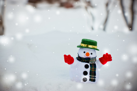 Snow man stand among pile of snow. Morning sunshine is warming in winter. Welcome Christmas.