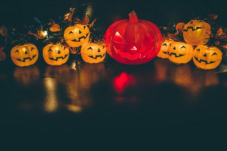 Halloween pumpkin party, Big terrible Pumpkin and happy pumpkin friends on wooden background.