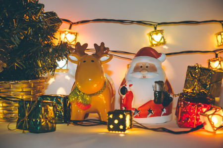 silent night: Santa claus, reindeer,  light bulb, and Ornament Christmas items decorate for the silent night. Merry xmas and Happy new year. Stock Photo