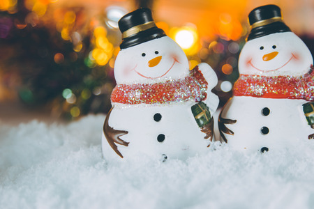 silent night: snowman and Santa clause in snow with Ornament Christmas items background, decorate for the silent night. Merry xmas and Happy new year. Stock Photo