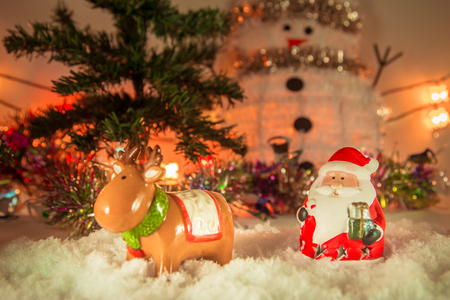 silent night: Santa claus, reindeer stand in snow and Ornament Christmas items decorate for the silent night. Merry xmas and Happy new year. Snow flake is falling down.