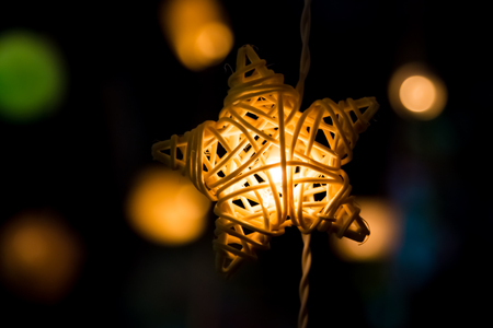 Hanging star shape Fancy light bulbs with glowing and lighting. Stock Photo
