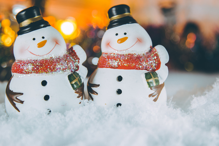 silent night: Snowman stand in a plie of snow with Ornament Christmas items background, decorate for the silent night. Merry xmas and Happy new year. Stock Photo