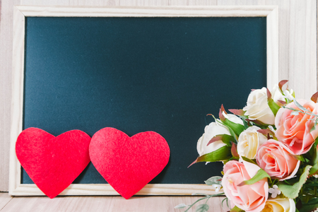 weet roses and 2 heart put on wooden floor with the blackboard and s, Valentine day concept