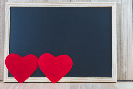 2 heart put on wooden floor with the blackboard, Valentine day concept