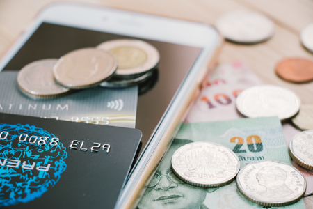 Credit card,  plastic money, put on smartphone and bank note. Electronic money and ewallet concept, new payable in Fintech era.
