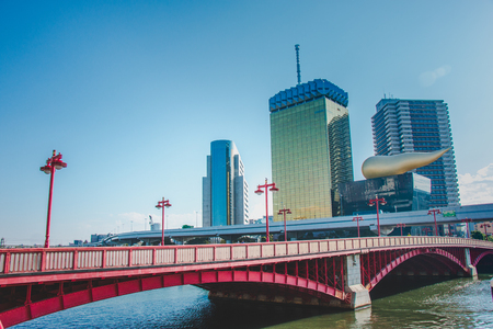 view of Azumabashi Riverside, Red Bridge on the Sumida River,opposite site can see Tokyo sky tree at Asakusa district Tokyo, Japan. Stock Photo