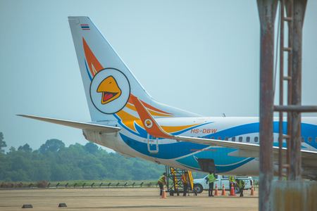 Oct 18 2016 Ubonratchatani, Thailand:  Nok Airline  plane landed at Ubonratchatanee international airport. staff carry out the luggage from the aireplane. Editorial