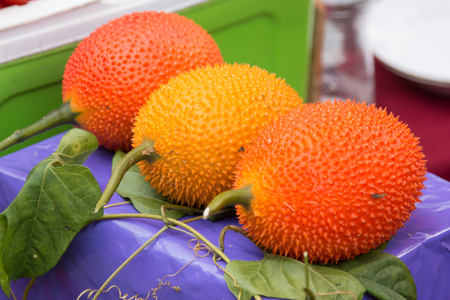Gac fruits in Thai market, Gac fruit herb for beauty skin and available in Asia. Stock Photo