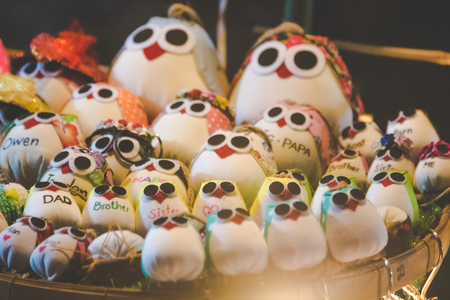 hand bell: Varity cute owl family doll, Shape Cushion handcaraft  on cloth and rope displayed in Thailand market Handicraft shop.