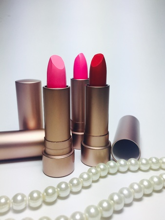 Set of moisturize lipstick and powder foundation pink  and red color set