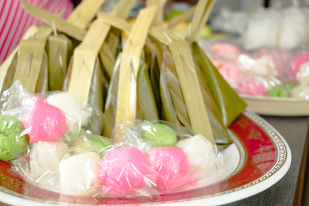 jelly beans: Kha nom Tuay Fuu and Kha nom Sood Sai, Powder and sweet  Coconut on package; Thai sweet dessert and snack, make offering to monk, local traditional Thai food.
