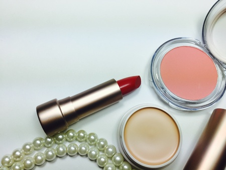 Red moisturize lipstick with pink blush on and powder foundation beauty concept