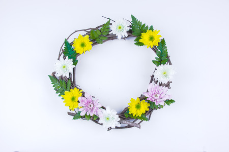 Floral and branch round crown(wreath) white daisy and green leaf. Isolated white background. summer and spring. Space for text. Flat lay, top view