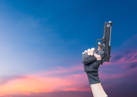 Hand gun isolated Caution On the sky background