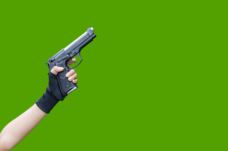 Woman holding hand gun isolated white background cliping part.