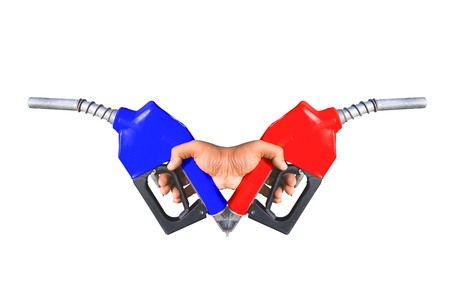 Fuel nozzle Hand holding red and natural sea power technology icons that are separated from the ground.