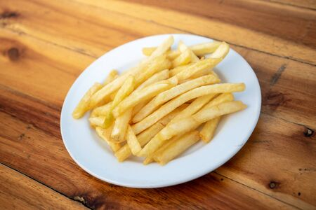 French fries in local dishes on wooden floors