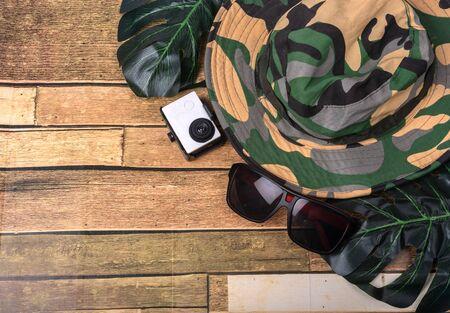 Travel, rest, camera, hat, glasses on wooden floors Stock Photo