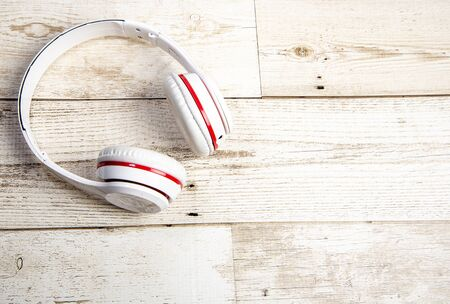 Red earbuds with red 7.1 hi end system on a wooden floor