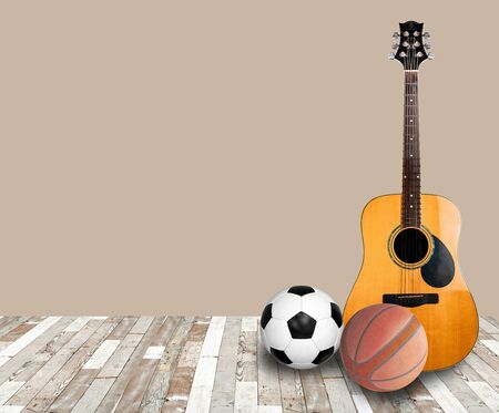 Wooden guitar, football, basketball on the ground, not inclined, sports, music, leisure, leisure, clipingpart
