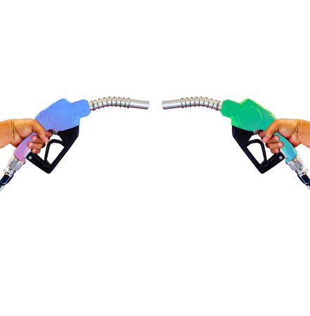 Holding a fuel nozzle against the filling nozzle a hand in his hand that separates from the background