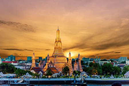 Wat Arun Temple at sunset in bangkok Thailand. Wat Arun is a Buddhist temple in Bangkok Yai district of Bangkok, Thailand, Wat Arun is among the best known of Thailand's landmarksPhotos of beautiful orange sky lights. Reklamní fotografie