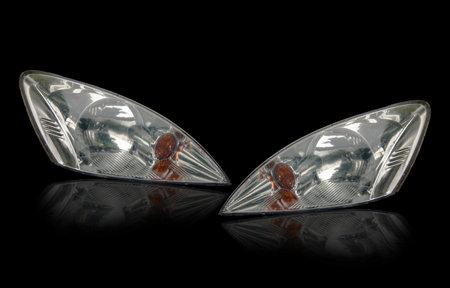 Car headlight, reflection, closeup isolated on white background