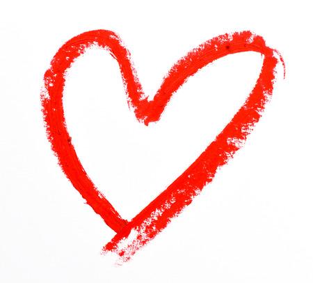 faire l amour: forme de coeur rouge à lèvres sur fond blanc