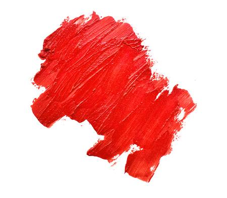 smudged lipsticks on white background photo