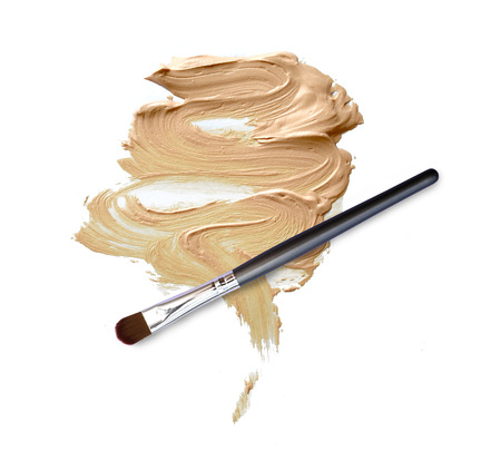 grooming product: makeup brush with smeared liquid foundation