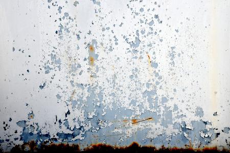 rusty metal wall grunge background with peeling paint texture Reklamní fotografie
