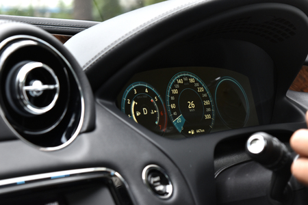 Console luxury super car inside speed automatic drive control and monitor scale interior detail front vehicle