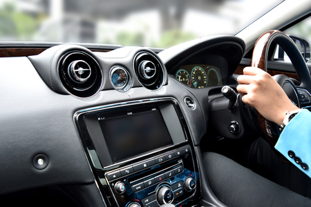 Movement speed inside car view with camera and radio luxury vehicle interior by moving wheel driver Banque d'images - 106138219